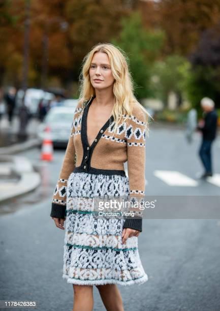 Megan Adelaide Schaefer seen wearing skirt brown cardigan outside Chanel during Paris Fashion Week Womenswear Spring Summer 2020 on October 01 2019...