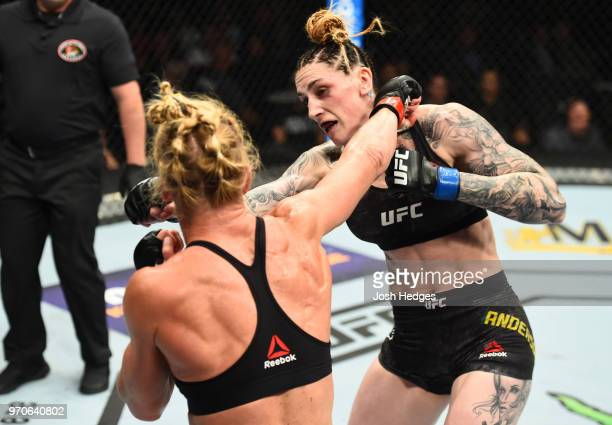 Megan Anderson of Australia and Holly Holm exchange punches in their women's featherweight fight during the UFC 225 event at the United Center on...