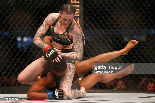 Megan Anderson of Australia punches Zarah Fairn of France in the Women's featherweight bout during UFC 243 at Marvel Stadium on October 06 2019 in...