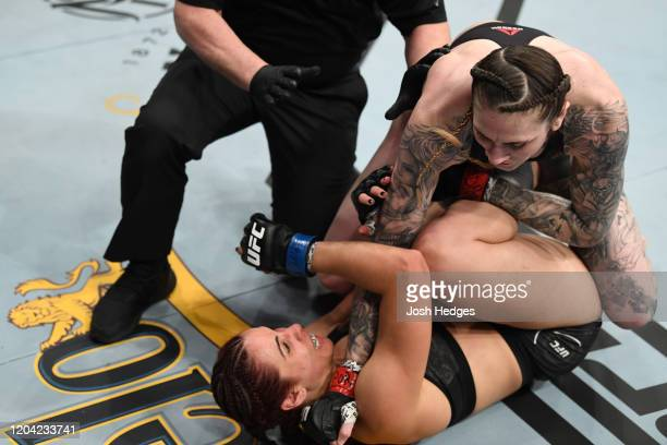 Megan Anderson punches Norma Dumont in their women's featherweight bout during the UFC Fight Night event at Chartway Arena on February 29 2020 in...