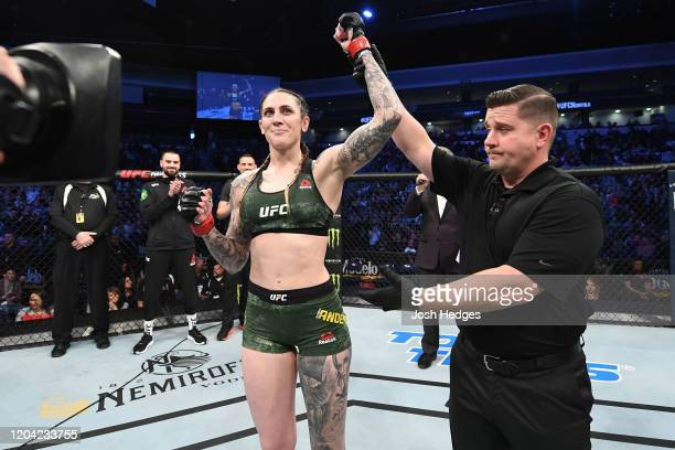 Megan Anderson reacts after defeating Norma Dumont in their women's featherweight bout during the UFC Fight Night event at Chartway Arena on February...