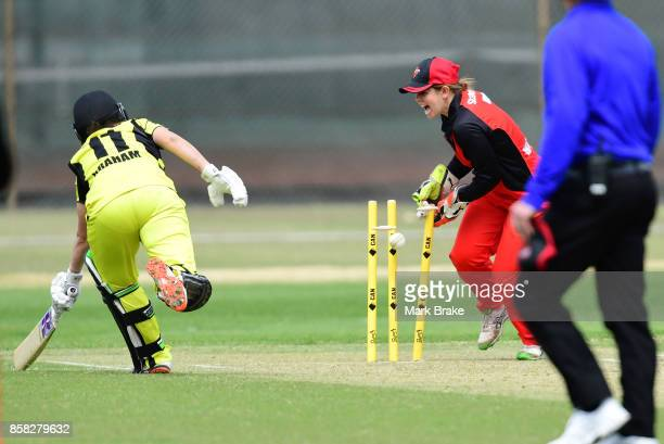Megan Banting runs out Heather Graham during the WNCL match between South Australia and Western Australia at Adelaide Oval No2 on October 6 2017 in...