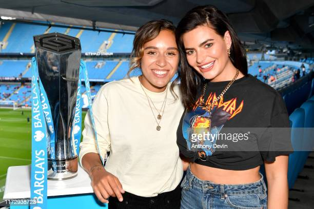 Megan Barton-Hansen and Barclays football ambassador Chelcee Grimes pose with the Barclays FA Women's Super League trophy during the Barclays FA...