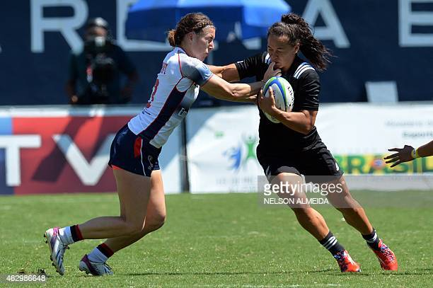 Megan Bonny of USA tackles Portia Woodman of New Zealand during their quarter final match of the IRB Women's Sevens World Series in Barueri, some 30...