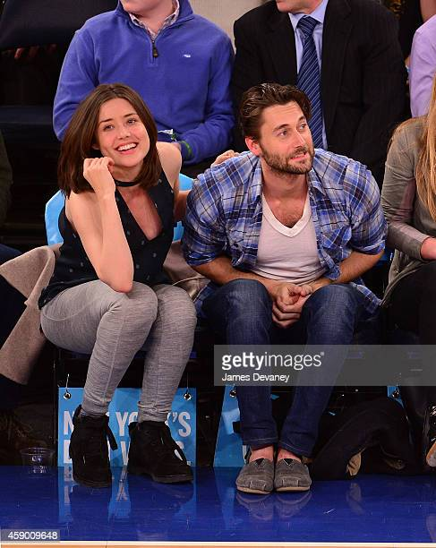 Megan Boone and Ryan Eggold attend the Utah Jazz vs New York Knicks game at Madison Square Garden on November 14 2014 in New York City