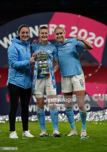 Megan Campbell, Ellen White and Steph Houghton of Manchester City celebrate with the Vitality Women's FA Cup Trophy following their team's victory in...