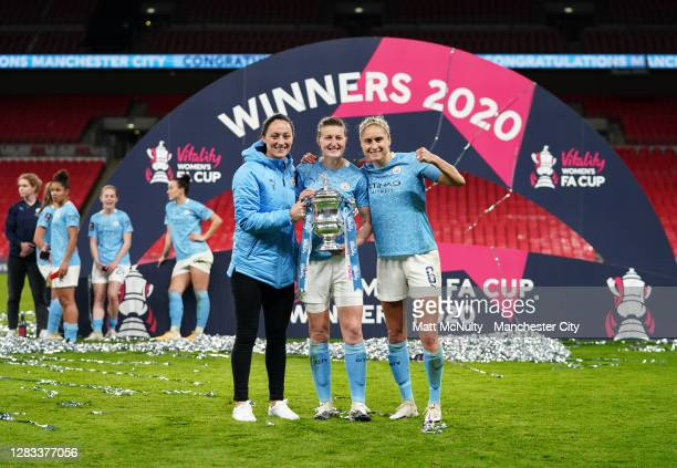 Megan Campbell, Ellen White and Steph Houghton of Manchester City celebrate with the trophy during the Vitality Women's FA Cup Final match between...