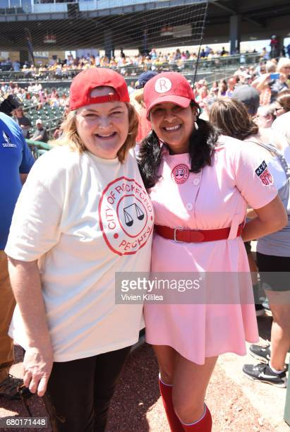 Megan Cavanagh and a fan attend 'A League of Their Own' 25th Anniversary Game at the 3rd Annual Bentonville Film Festival on May 7 2017 in...