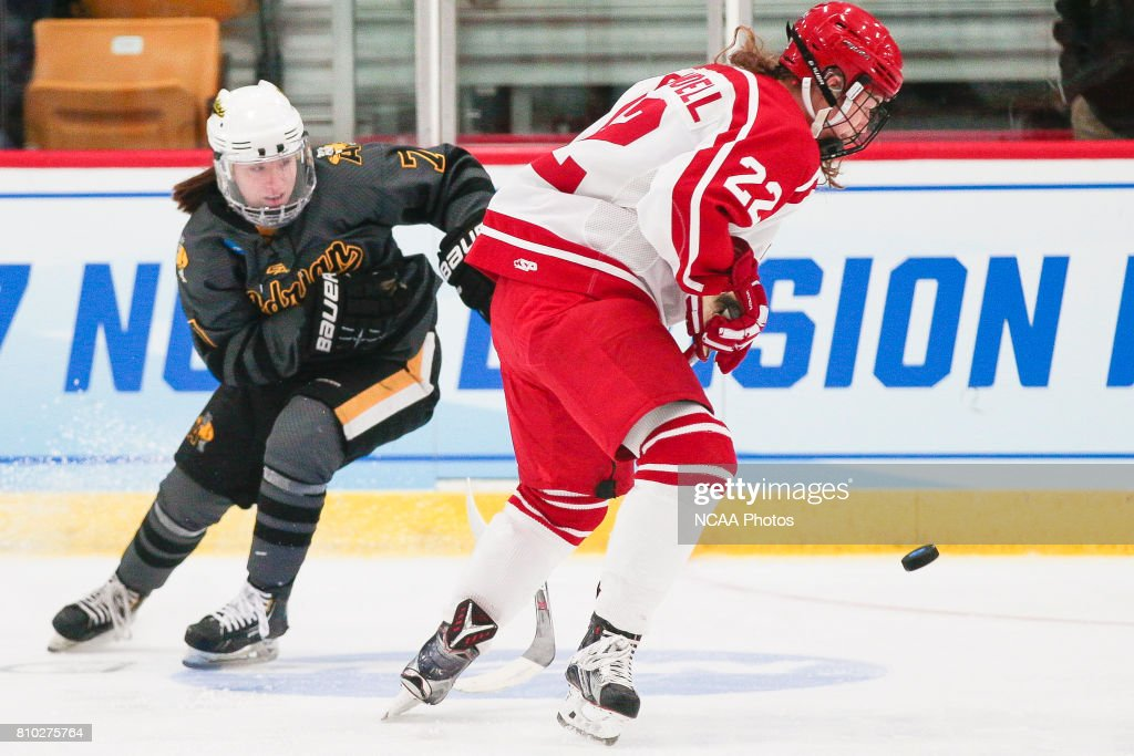 babd5e73872 Megan Crandell of Plattsburgh State University chases a puck during ...