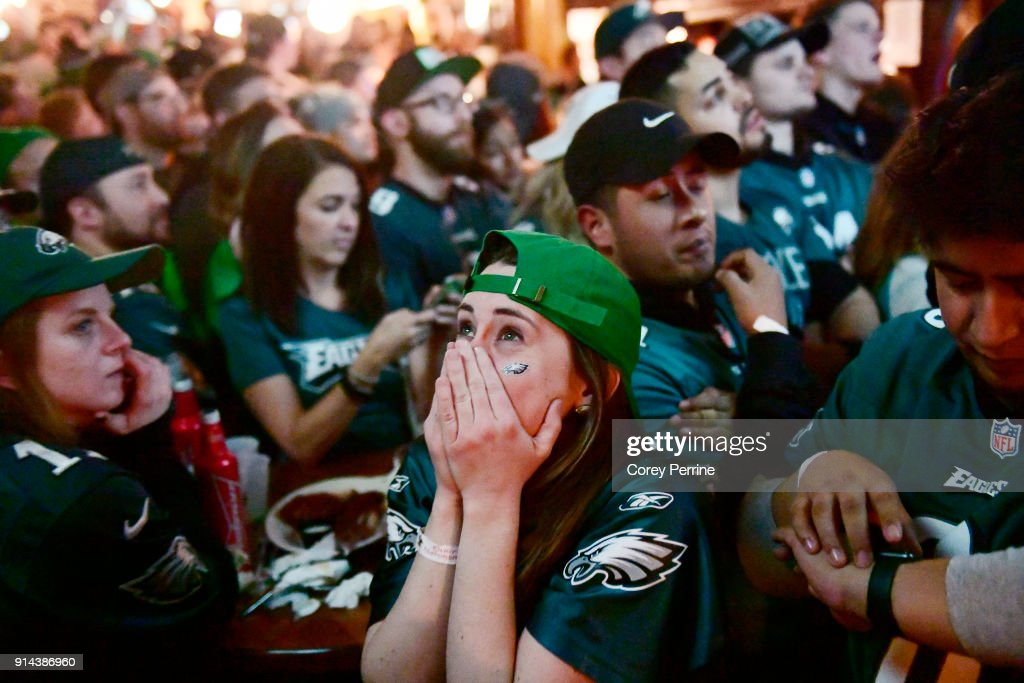 Megan Donovan of Philadelphia, Pennsylvania reacts to a Patriots score while watching Super Bowl LII on TV at The Irish Pub on February 4, 2018 in downtown Philadelphia, Pennsylvania. The Philadelphia Eagles defeated the favored New England Patriots winning their first Super Bowl championship 41-33.