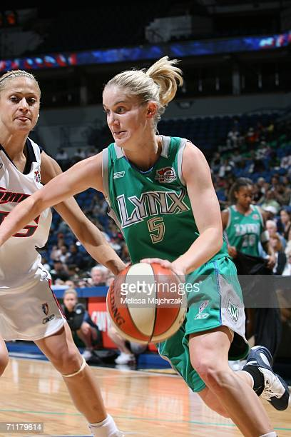 Megan Duffy of the Minnesota Lynx drives to the basket against Anastasia Kostaki of the Houston Comets on June 11 2006 at the Target Center in...