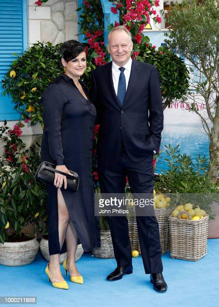 Megan Everett and Stellan Skarsgard attend the UK Premiere of Mamma Mia Here We Go Again at Eventim Apollo on July 16 2018 in London England