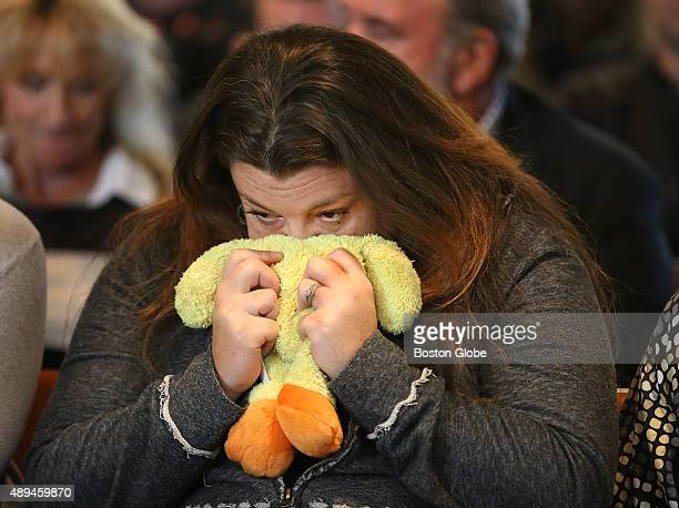 """Megan Fewtrell, godmother of Bella Bond, clutches """"Ducky,"""" Bella's favorite stuffed animal that was kept at Fewtrell's home. She waits for the..."""