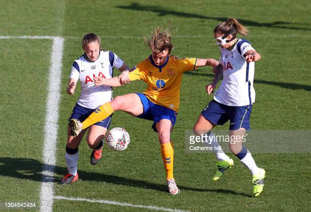 Megan Finnigan of Everton is challenged by Angela Addison and Ria Percival of Tottenham Hotspur during the Barclays FA Women's Super League match...
