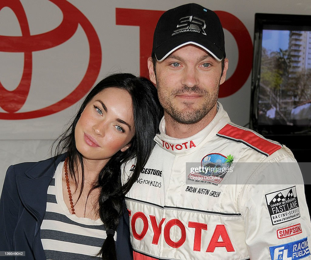 Megan Fox and Brian Austin Green pose at race day for the 34th Annual Toyota Pro/Celebrity Race at the Long Beach Grand Prix on April 17, 2010 in Long Beach, California