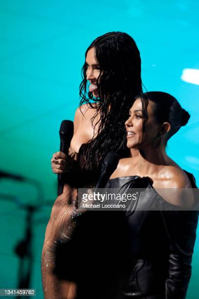 Megan Fox and Kourtney Kardashian speak onstage during the 2021 MTV Video Music Awards at Barclays Center on September 12, 2021 in the Brooklyn...