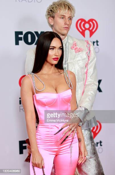 Megan Fox and Machine Gun Kelly attend the 2021 iHeartRadio Music Awards at The Dolby Theatre in Los Angeles, California, which was broadcast live on...