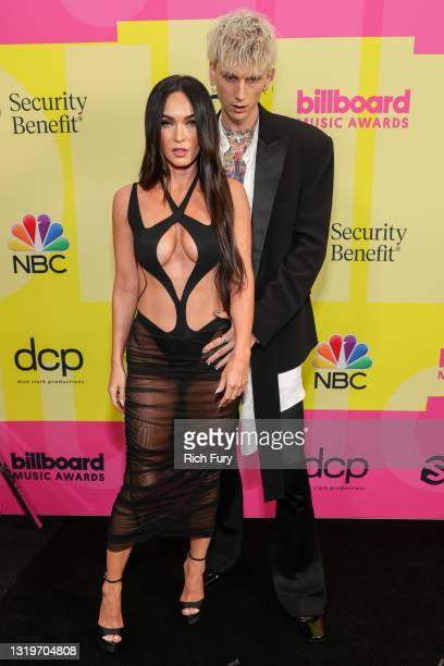 Megan Fox and Machine Gun Kelly poses backstage for the 2021 Billboard Music Awards, broadcast on May 23, 2021 at Microsoft Theater in Los Angeles,...