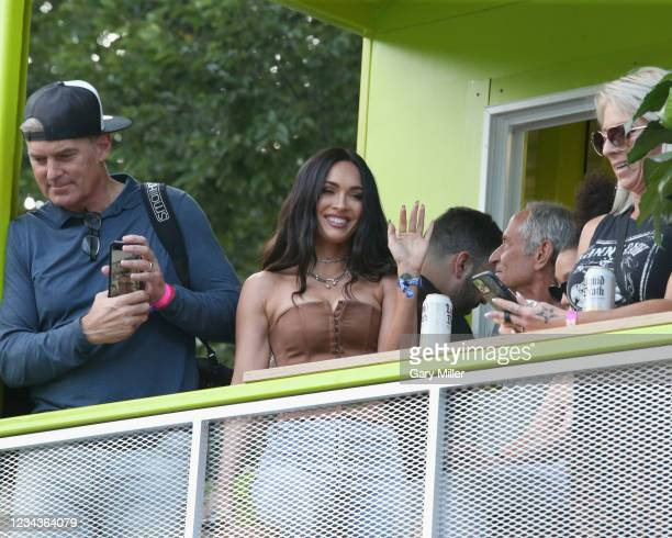 Megan Fox attends Machine Gun Kelly's performance during day three of the 30th anniversary of Lollapalooza at Grant Park on July 31, 2021 in Chicago,...