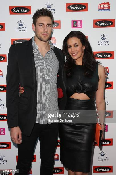 Megan Gale and Shaun Hampson pose on the red carpet prior to the Robbie Williams performance at the Palms at Crown on September 14 2014 in Melbourne...