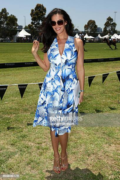 Megan Gale poses as she attends the Waterford Crystal Polo in the City at Albert Park on November 29 2014 in Melbourne Australia