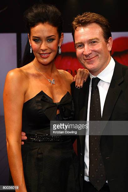 Megan Gale poses with David Jones CEO Mark McInnes after walking the catwalk for the last time at the David Jones Winter 2008 Collection Launch 'A...