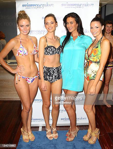 Megan Gale poses with models as she attends the Swimwear Galore flagship store launch in Malvern on November 24 2011 in Melbourne Australia