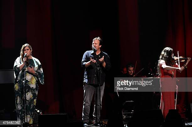 Megan Garrett Mark Hall and Melodee Devevo of muscial group Casting Crowns perform onstage during the 3rd Annual KLOVE Fan Awards at the Grand Ole...