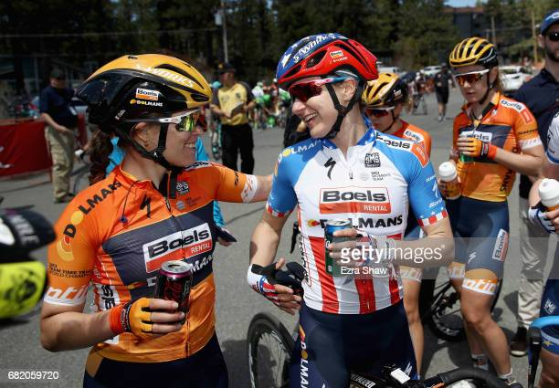 Megan Guarnier of the United States riding for BoelsDolmans Cycling Team is congratulated by teammate KarolAnn Canuel of Canada after Guarnier won...