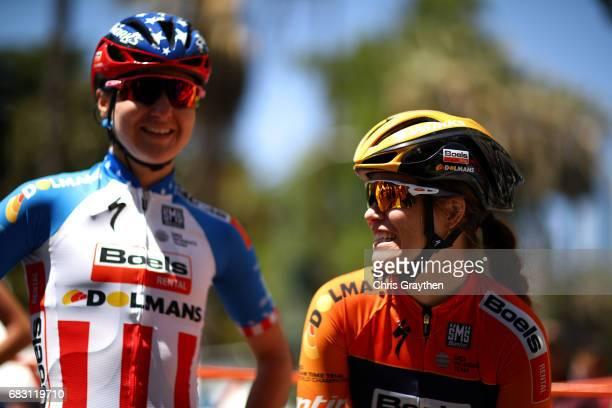 Megan Guarnier of the United States riding for BoelsDolmans cycling team talks with KarolAnn Canuel of Canada riding for BoelsDolmans prior to Stage...