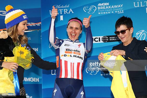 Megan Guarnier of the United States riding for the Boels-Dolmans Cycling Team celebrates on the podium as she receives the yellow race leader's...