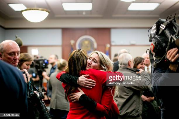 Megan Halicek a survivor of sexual abuse by disgraced doctor Larry Nassar hugs a supporter after the sentencing of Nassar in Ingham County Circuit...