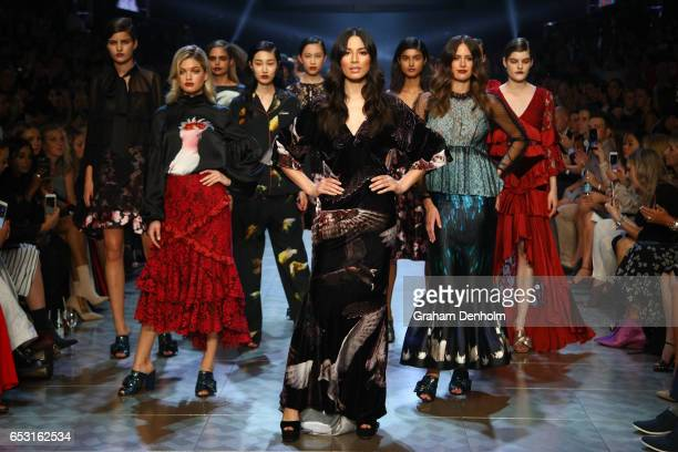Megan Irwin Jessica Gomes and Jasinta Franklin pose on the runway during the David Jones Gala Runway Show at VAMFF on March 14 2017 in Melbourne...