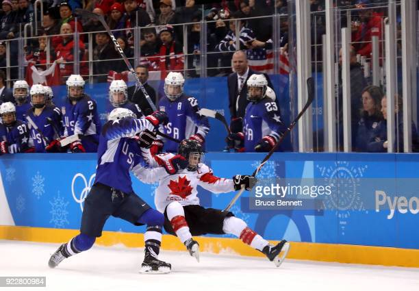 Megan Keller of the United States collides with MariePhilip Poulin of Canada and is called for an illegal hit in overtime during the Women's Gold...