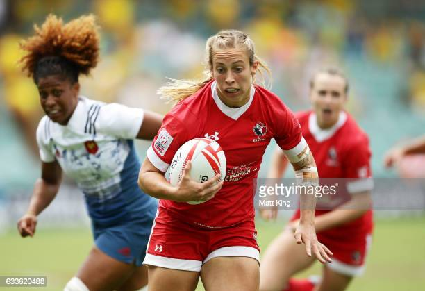 Megan Lukan of Canada makes a break during the womens pool match between Canada and France in the 2017 HSBC Sydney Sevens at Allianz Stadium on...