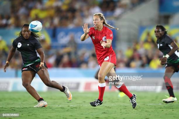 Megan Lukan of Canada passes in the match between Kenya and Canada during Rugby Sevens on day nine of the Gold Coast 2018 Commonwealth Games at...