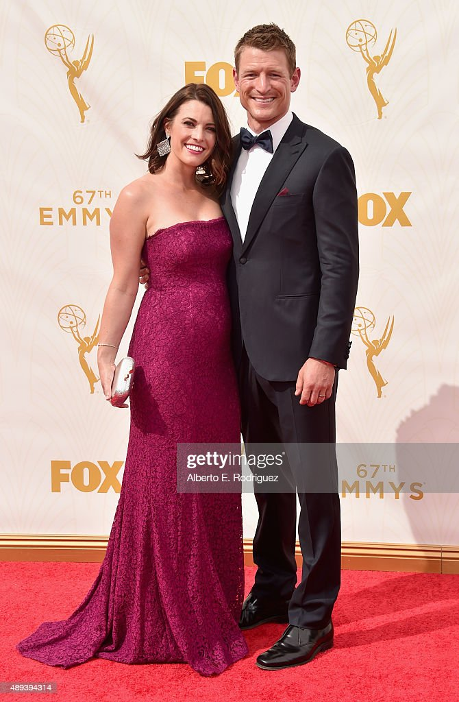 Megan Marie Coughlin (L) and actor Philip Winchester attend the 67th Emmy Awards at Microsoft Theater on September 20, 2015 in Los Angeles, California. 25720_001