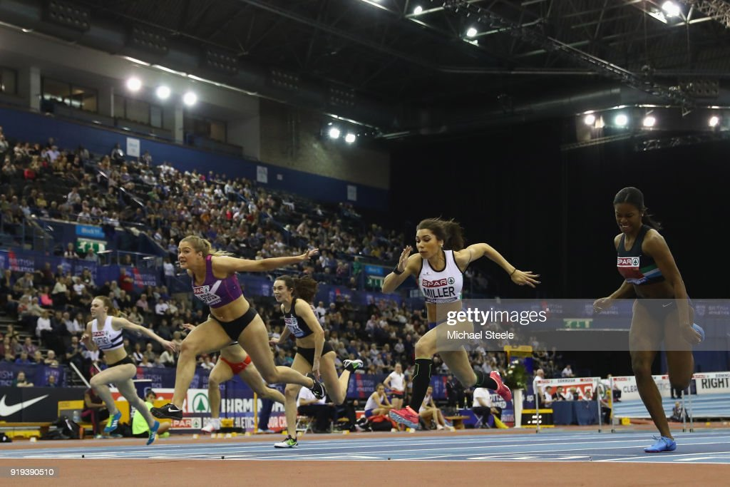 Megan Marrs (L) of Hounslow dips at the line to win the women's 60m hurdles final from Yasmin Miller (R) of Derby AC during day one of the SPAR British Athletics Indoor Championships at Arena Birmingham on February 17, 2018 in Birmingham, England.