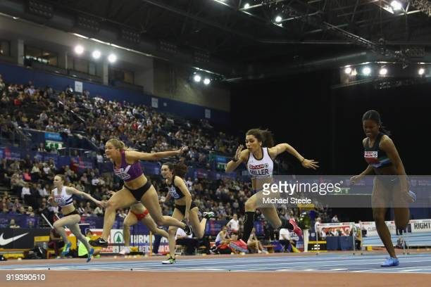 Megan Marrs of Hounslow dips at the line to win the women's 60m hurdles final from Yasmin Miller of Derby AC during day one of the SPAR British...
