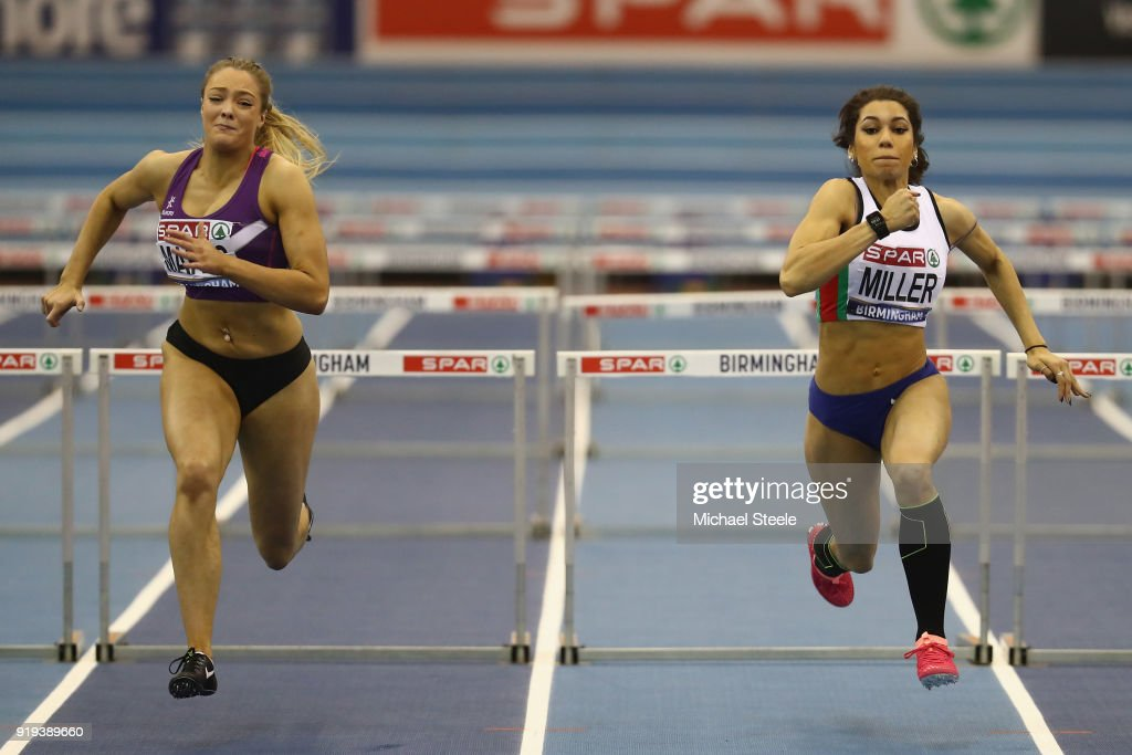 Megan Marrs (L) of Hounslow wins the women's 60m hurdles final from Yasmin Miller (R) of Derby AC during day one of the SPAR British Athletics Indoor Championships at Arena Birmingham on February 17, 2018 in Birmingham, England.