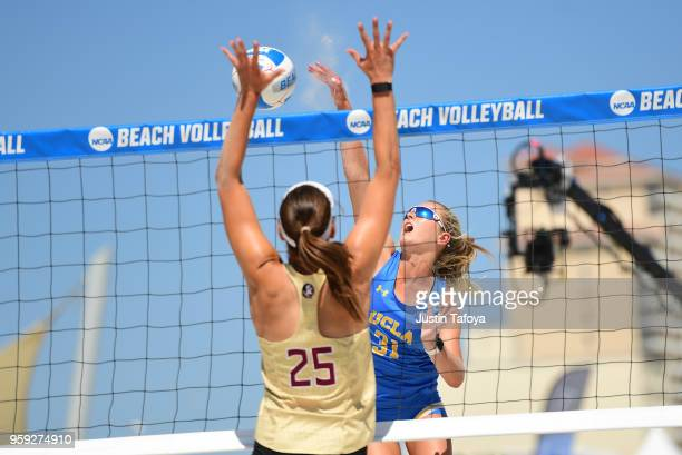 Megan McNamara of UCLA and Victoria Paranagua of Florida State University compete at the net during the Division I Women's Beach Volleyball...