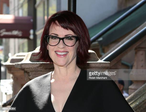 """Megan Mullally attends the """"It's Only A Play"""" Cast Photocall at Joe Allen Restaurant on August 19, 2014 in New York City."""
