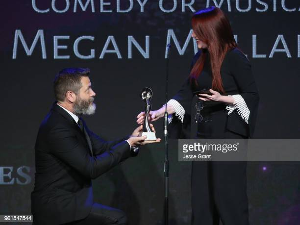 Megan Mullally receives award from Nick Offerman onstage at the 43rd Annual Gracie Awards at the Beverly Wilshire Four Seasons Hotel on May 22 2018...