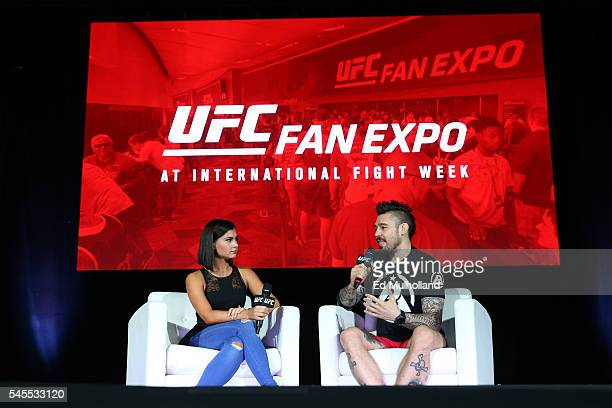 Megan Olivi and Dan Hardy hold a Q-and-A for fans during day 1 of the UFC Fan Expo at the Las Vegas Convention Center on July 8, 2016 in Las Vegas,...