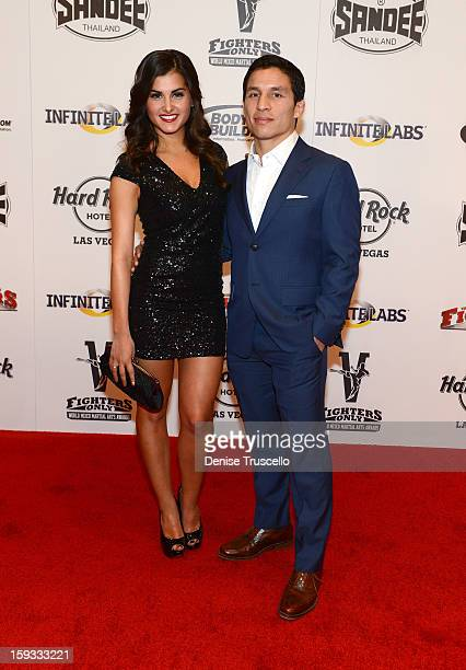 Megan Olivi and mixed martial artist Joseph Benavidez arrive at the Fighters Only World Mixed Martial Arts Awards 2013 at the Hard Rock Hotel Casino...