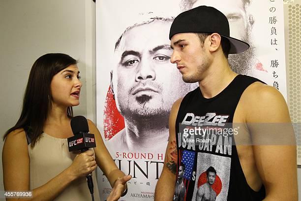 Megan Olivi talks with Myles Jury backstage during the UFC Fight Night event inside the Saitama Arena on September 20 2014 in Saitama Japan