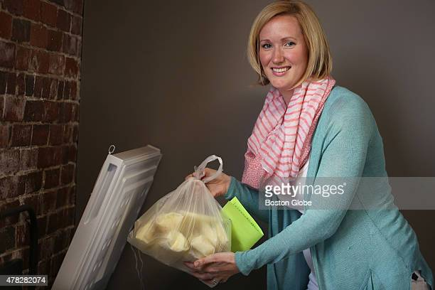 Megan O'Neill director of lactation support lifts a bag of frozen donated breast milk from the freezer Acelleron Maternal Health Wellness has a new...