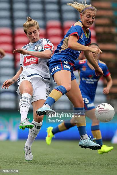 Megan Oyster of the Jets competes for the ball with Natasha Dowie of the Victory during the round 12 WLeague match between the Newcastle Jets and the...