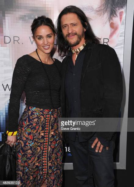Megan Ozurovich and actor Clifton Collins Jr attend the premiere of Transcendence at Regency Village Theatre on April 10 2014 in Westwood California