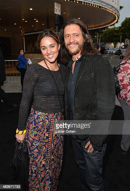Megan Ozurovich and actor Clifton Collins Jr attend the premiere of Warner Bros Pictures and Alcon Entertainment's Transcendence at Regency Village...